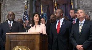 South Carolina Gov. Nikki Haley along with Sen. Lindsey Graham (R-SC) (R) and other  lawmakers and activists delivers a statement to the media asking that the Confederate flag be removed from the state capitol grounds.(Photo by Joe Raedle/Getty Images)