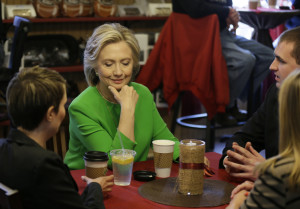 Hillary Rodham Clinton meets with locals at the Jones St. Java House, LeClaire, Iowa. (AP Photo/Charlie Neibergall)