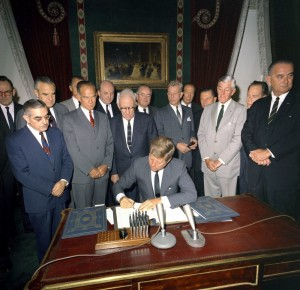 John Kennedy signs test ban treaty flanked by Senators Fulbright and Dirksen and, of course, LBJ.