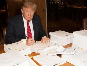 Trump signing the tax return he refuses to release
