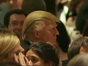 Trump having a grand time at the White House Correspondent's dinner in 2011